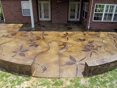 Beautiful concrete patio with trailing acid stained vines meandering the concrete surface.