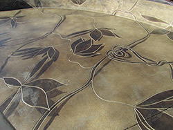 Engrave the edge of acid stain design into concrete to give a definite edge to the design.