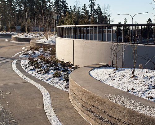 Over 5,000 Square Feet, and it's not difficult to see why. Entering or exiting the bridge, drivers navigate around a custom-colored, stamped concrete roundabout that directs the flow of traffic.
