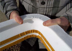 Using fiberglass tape, a polystyrene foam form can be bent into a curve with a smooth, tight radius that maintains the profile with minimum distortion.