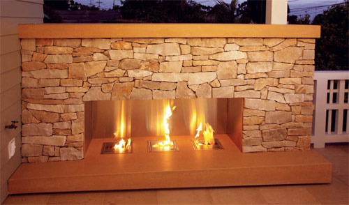 A fireplace installed on an outdoor balcony in Pacific Beach, Calif. The fireplace is 10 feet across and equipped with three EcoSmart burners. The top piece was hollow-cast, but it's still heavy — it weighs about 600 pounds.