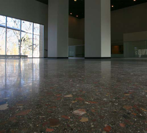 The facility floor is textured with stones, some as large as an inch and a half in diameter, all brought to life with a grind and polish process