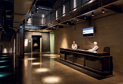 CMU walls and polished concrete floors dominate the museum's point of entry for tours.