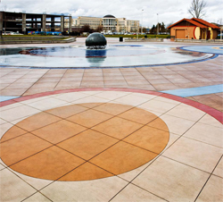 Circular lines created with concrete coloring techniques in this outdoor meeting space.