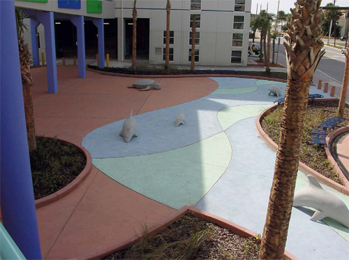 This walkway in Florida was created with integral color. The integral colors used are Cranberry, Marina Green and Powder Blue, which were originally produced by QC Construction Products. They are now manufactured by ChemSystems Inc. Photos courtesy of Chris Sullivan