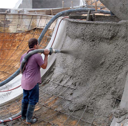 Shotcrete is applied to a ramp. The bulk of this job was shotcrete work. January 2010
