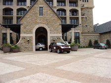 An expansive driveway in front of a hotel that has been stamped and stained with concrete stain.