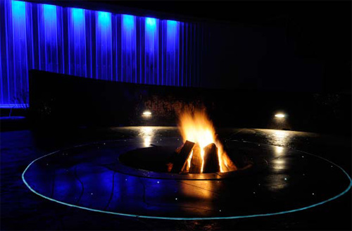 The fire pit and its fiber optic lighting, switched on at night.