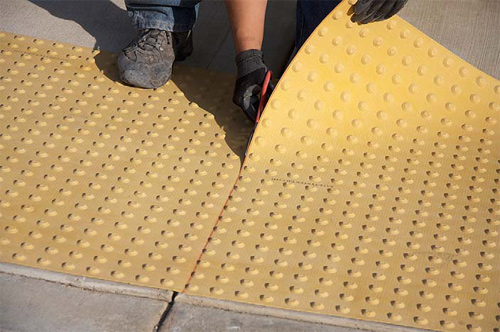 SafetyStepTD is a system of truncated domes on flexible mats that can be easily cut to any shape.
