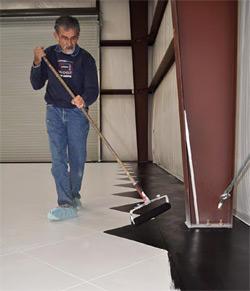 Julio Hallack applies the concrete color produced by Miracote.