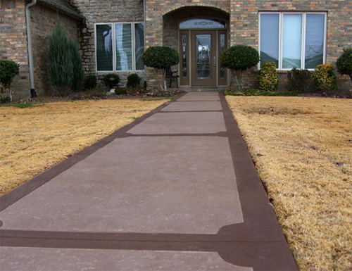 A front-entrance walkway done in ColorJuice Sand and trimmed with two applications of ColorJuice Chocolate. The walkway was finished with ColorJuice Exterior Sealer.
