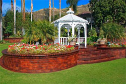 The resort wanted do something unique with its concrete sidewalks and hardscapes, which were at the time a dull salmon color. The area serves as a gathering area for golfers and wedding parties, so the client wanted to create a richer look that blended more with the surrounding landscape. House and his crew used products from Concrete Solutions to create a gorgeous masterpiece.
