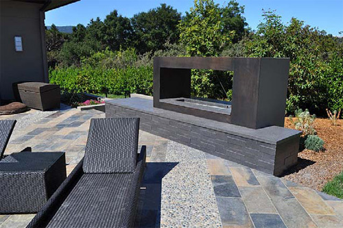 Outdoor space with a fireplace custom made out of concrete.