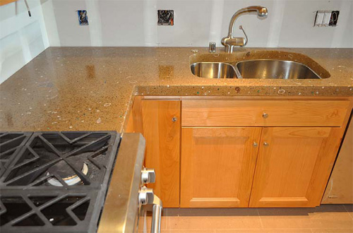 Custom concrete countertops in a light brown color with an under counter sink.