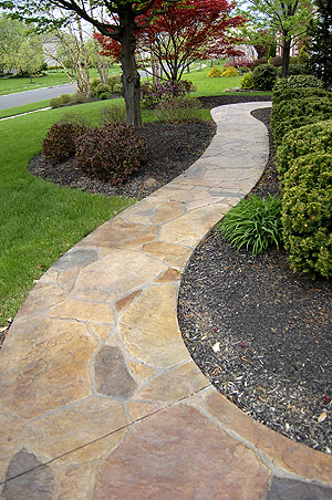 Stone rock-like pathway made with stamped concrete and concrete stain
