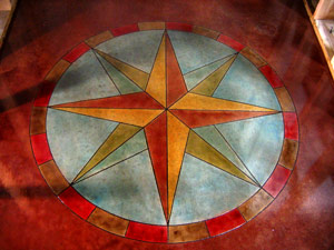 A yellow and red compass rose on a blue and red background.