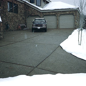 A snowmelting system can be manually controlled or set up with a sensor that will turn it on automatically when snow falls.