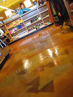 The New Leaf Market in Half Moon Bay, Calif., has a floor created using a two-pass Magic-troweled Sgraffino overlay and dyed graphics. Photo courtesy of The Concretist.