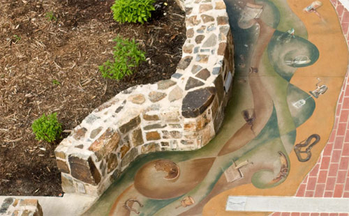 Concrete artisan and Southern Arkansas University art professor Steven Ochs recently had the opportunity to create a public art project depicting the Arkansas River and the state's history. 30 | www.ConcreteDecor.net | September/October 2009 Photos courtesy of Steven Ochs