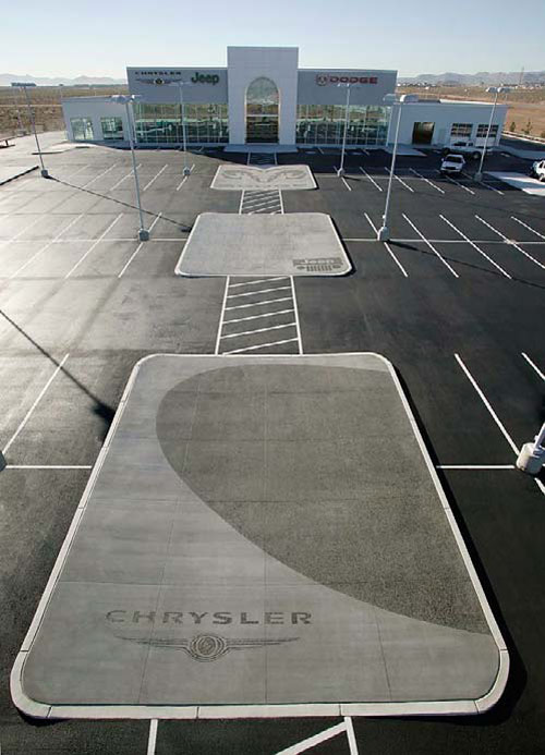 Recycled Glass Aggregate - Completed concrete pads represent vehicle makes sold.