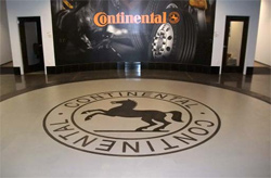Continental logo that has been stenclied, dyed and polished into this concrete floor.