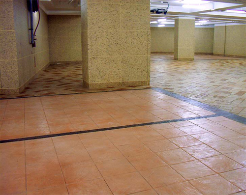 The parking stalls were stamped with Concrete Solutions' Ashlar-Italian Slate 12-inch tiles. The black lines were textured with Italian Slate texture mats, and the driveways with English Fieldstone Large stamps.