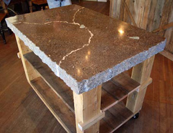 A display table with a blended-color marbled top and hand-chiseled edges.